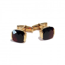 Gold cufflings with garnet