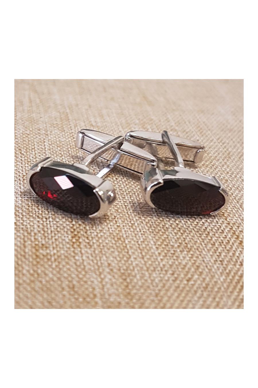 Silver cufflings with garnet